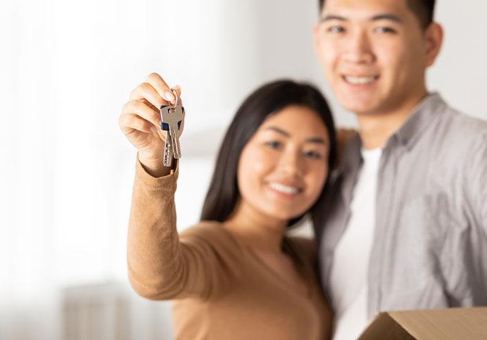 Image of a couple holding keys
